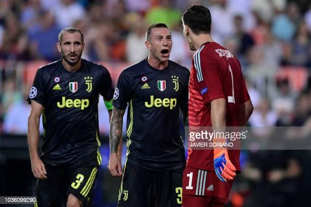 Juventus' Italian goalkeeper Wojciech Szczesny celebrates with Juventus' Italian defender Giorgio Chiellini and Juventus' Italian midfielder Federico...