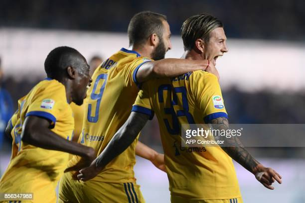 Juventus' Italian midfielder Federico Bernardeschi celebrates after scoring a goal during the Italian Serie A football match between Atalanta and...