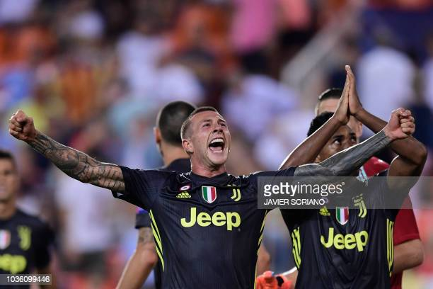 Juventus' Italian midfielder Federico Bernardeschi celebrates at the end of the UEFA Champions League group H football match between Valencia CF and...