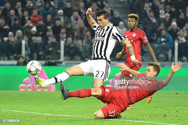 Juventus' Italian midfielder Stefano Sturaro kicks the ball to score next to Bayern Munich's German midfielder Joshua Kimmich during the UEFA...
