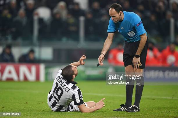 Juventus' Leonardo Bonucci and Referee Antonio Miguel Mateu Lahoz during the UEFA Champions League Round of 16 first leg soccer match between...