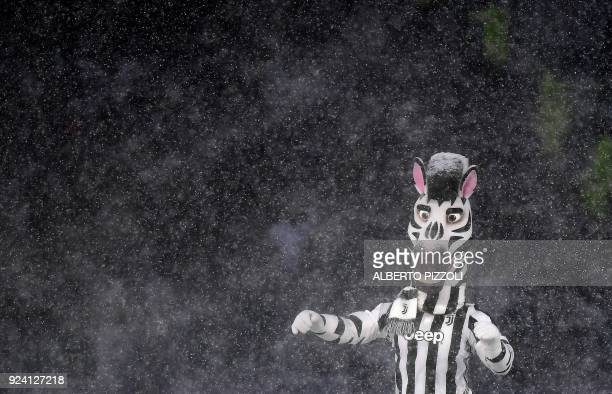 Juventus mascot 'Jay' performs under heavy snowfall before the postponed Italian Serie A football match Juventus versus Atalanta on February 25 2018...