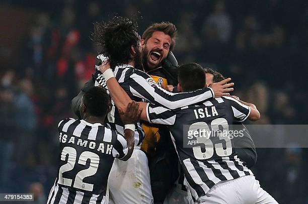 Juventus' midfielder Andrea Pirlo celebrates with teammates after scoring during the Italian Serie A football match Genoa Vs Juventus on March 16...