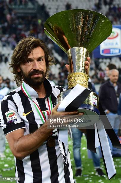 Juventus' midfielder Andrea Pirlo poses with the Italian League's trophy during a ceremony following the Italian Serie A football match Juventus vs...