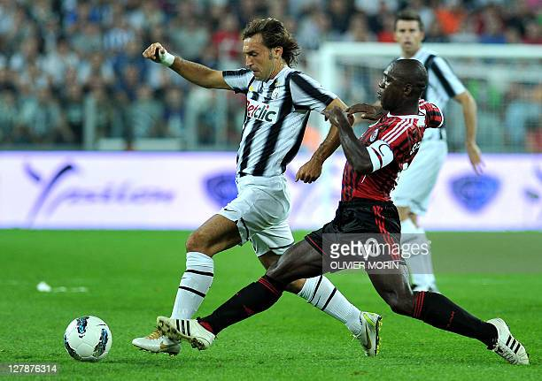 Juventus' midfielder Andrea Pirlo vies for the ball with AC Milan's Dutch midfielder Clarence Seedorf during the A series football match between...