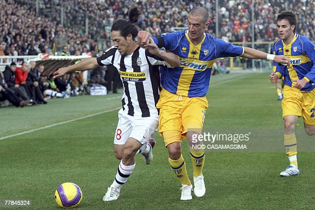Juventus midfielder Argentinian Mauro German Camoranesi challenges for the ball with AC Parma's defender Paolo Castellini during AC Parma vs Juventus...