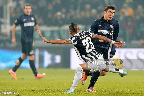 Juventus' midfielder Arturo Vidal fights for the ball with Inter Milan's midfielder Mateo Kovacic during the Italian Serie A football match Juventus...