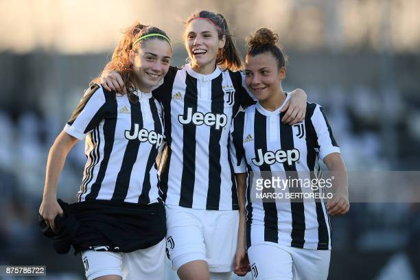Juventus' midfielder Benedetta Glionna Juventus' midfielder Cecilia Salvai and Juventus' defender Arianna Caruso celebrate at the end of the Women's...