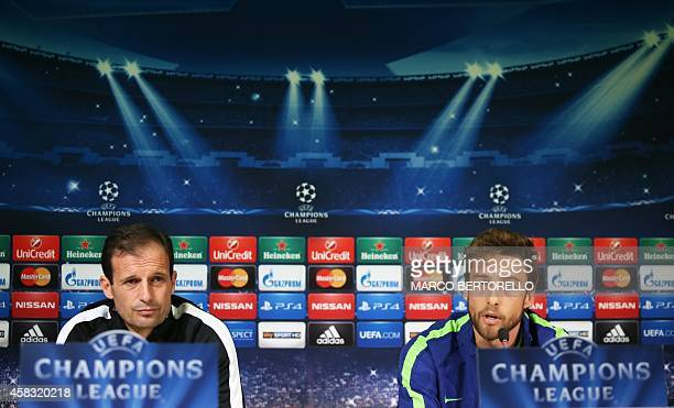 Juventus' midfielder Claudio Marchisio and Juventus' coach Massimiliano Allegri give a press conference on the eve of the Champions League football...
