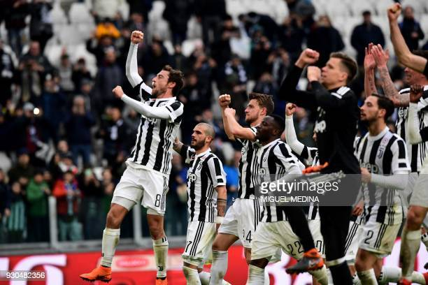 Juventus' midfielder Claudio Marchisio celebrates with teammates at the end of the Italian Serie A football match Juventus vs Udinese on March 11...