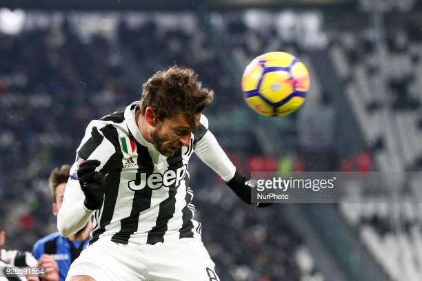 Juventus midfielder Claudio Marchisio heads the ball during the Coppa Italia semi final football match JUVENTUS ATALANTA on at the Allianz Stadium in...