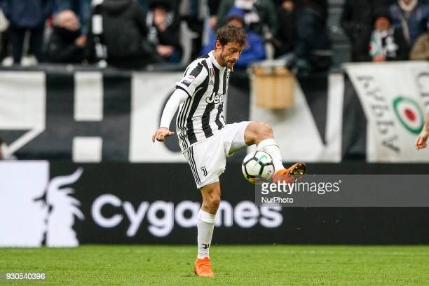 Juventus midfielder Claudio Marchisio reaches for the ball during the Serie A football match n28 JUVENTUS UDINESE on at the Allianz Stadium in Turin...