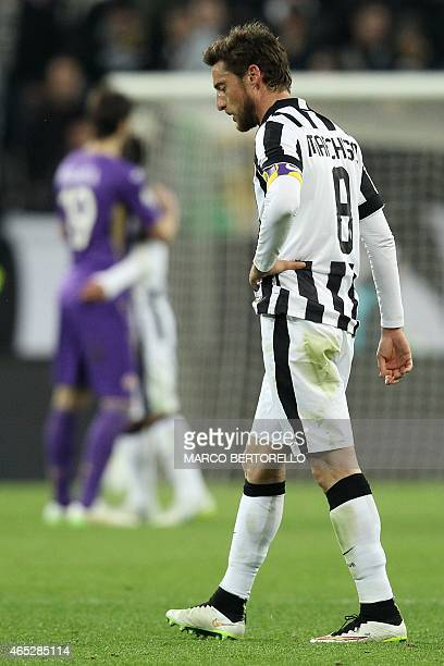 Juventus' midfielder Claudio Marchisio reacts at the end of the Italian Tim cup football match Juventus Vs Fiorentina on March 5 2015 at the Juventus...