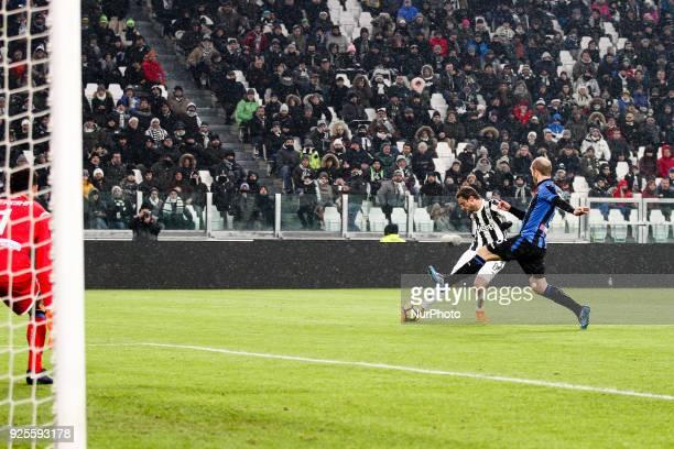 Juventus midfielder Claudio Marchisio shoots the ball during the Coppa Italia semi final football match JUVENTUS ATALANTA on at the Allianz Stadium...