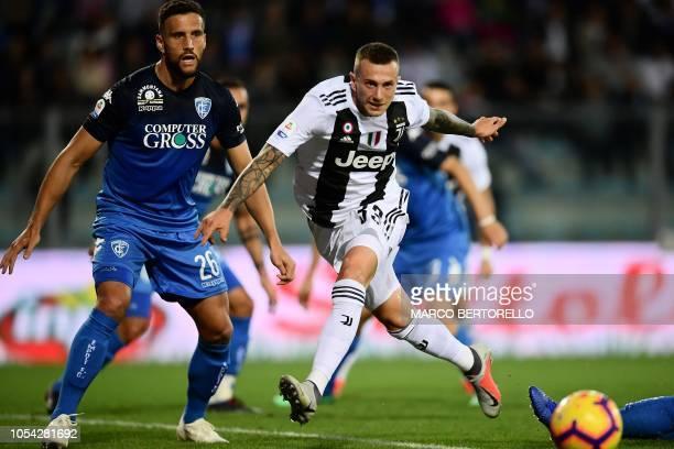 Juventus' midfielder Federico Bernardeschi vies with Empoli's defender Matias Silvestre from Argentina during the Italian Serie A football match...