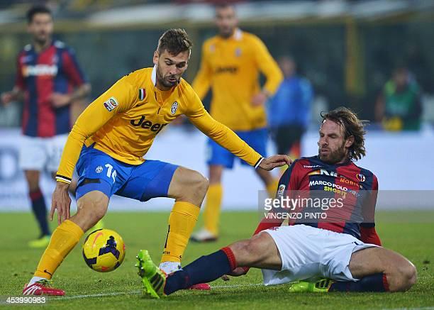 Juventus' midfielder Fernando Llorente vies with Bologna's defender Cesare Natali during the Serie A football match Bologna vs Juventus at Renato...