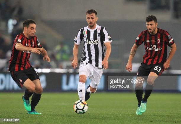 Juventus' midfielder from Bosnia and Herzegovina Miralem Pjanic controls the ball next to Milan's Italian forward Patrick Cutrone and Milan's Italian...