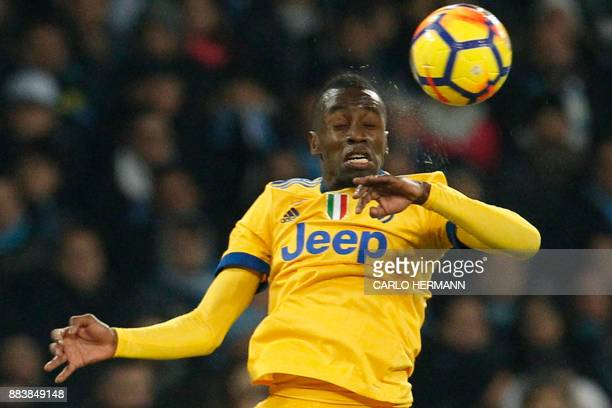 Juventus' midfielder from France Blaise Matuidi heads the ball during the Italian Serie A football match Napoli vs Juventus on December 1 2017 at the...