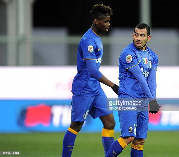 Juventus' midfielder from France Paul Pogba and Juventus' forward from Argentina Carlos Tevez react after missing a goal during the Italian Serie A...