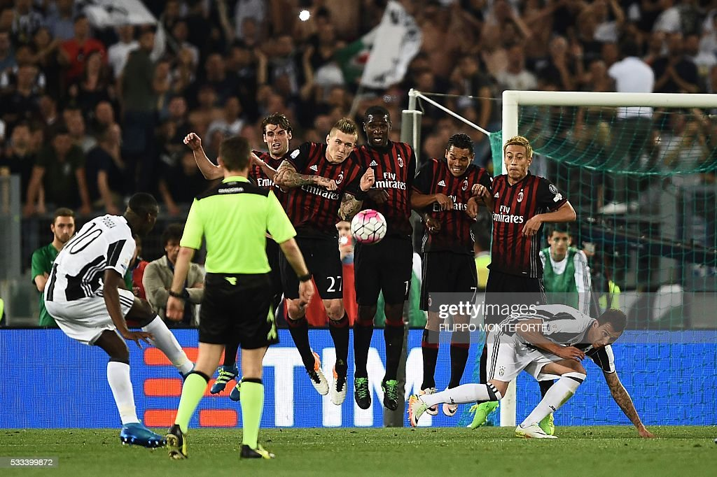 Juventus' midfielder from France Paul Pogba kicks the ball during the Italian Tim Cup final football match AC Milan vs Juventus on May 21, 2016 at the Olympic Stadium in Rome.