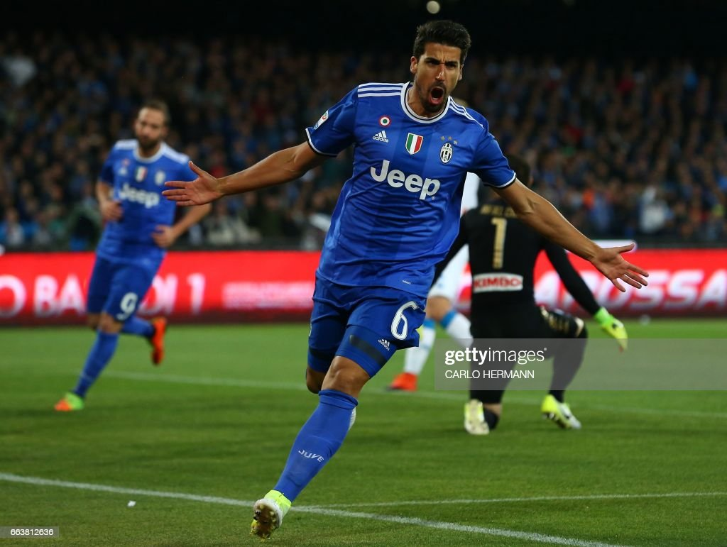 Juventus' midfielder from Germany Sami Khedira celebrates after scoring during the Italian Serie A football match SSC Napoli vs Juventus FC on April 2, 2017 at the San Paolo Stadium. /