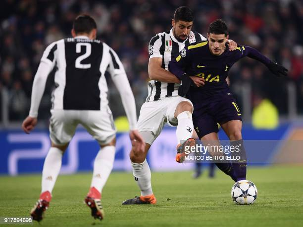 Juventus' midfielder from Germany Sami Khedira fights for the ball with Tottenham Hotspur's Argentinian midfielder Erik Lamela as Juventus' defender...