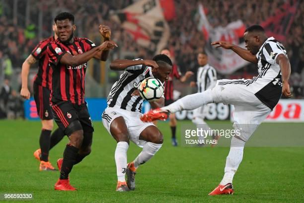 Juventus' midfielder from Ghana Kwadwo Asamoah kicks the ball in front of teammate Juventus' midfielder from France Blaise Matuidi and AC Milan's...