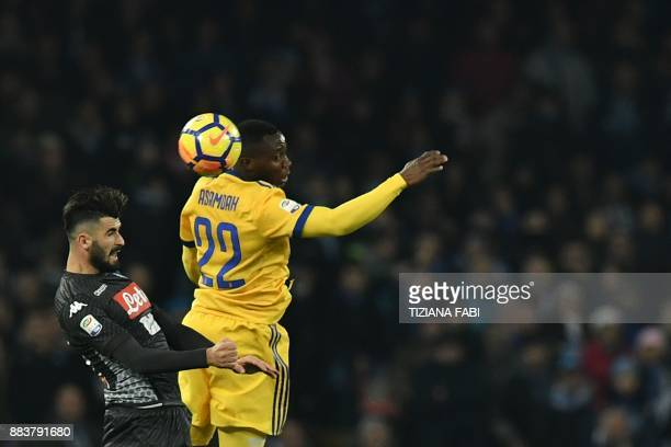 Juventus' midfielder from Ghana Kwadwo Asamoah vies with Napoli's defender from Albania Elseid Hysaj during the Italian Serie A football match Napoli...