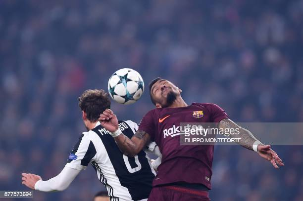 Juventus' midfielder from Italy Claudio Marchisio and Barcelona's Brazilian midfielder Paulinho head the ball during the UEFA Champions League Group...