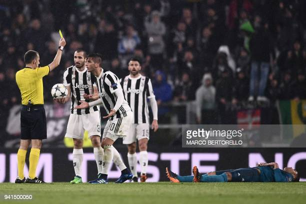 Juventus' midfielder from Uruguay Rodrigo Bentancur reacts as he is shown a yellow card by Turkish referee Cuneyt Cakir during the UEFA Champions...