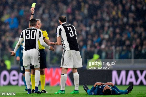 Juventus' midfielder from Uruguay Rodrigo Bentancur reacts with Juventus' Italian defender Giorgio Chiellini as he is shown a yellow card by Turkish...