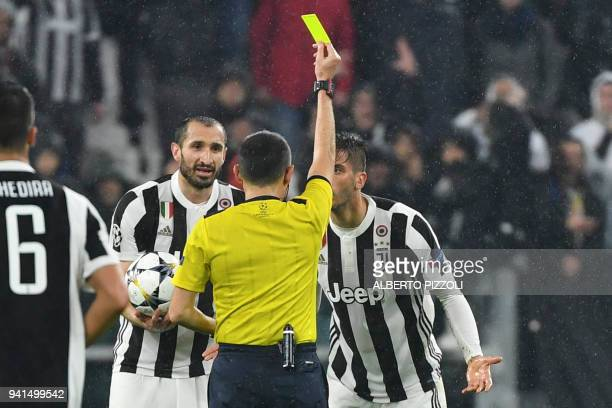 Juventus' midfielder from Uruguay Rodrigo Bentancur receives a yellow card from Turkish referee Cüneyt Cakir during the UEFA Champions League...