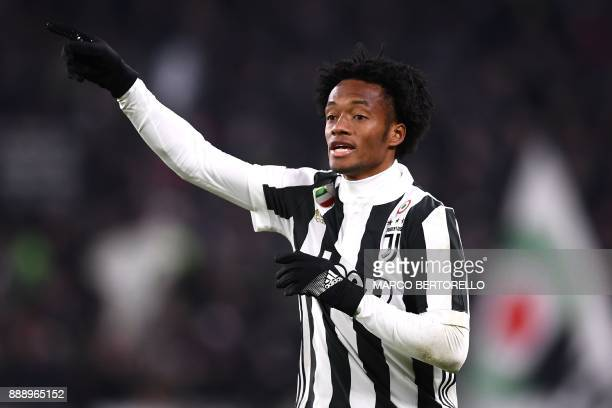 Juventus' midfielder Juan Cuadrado from Colombia gestures during the Italian Serie A football match Juventus vs Inter Milan on December 9 2017 at the...