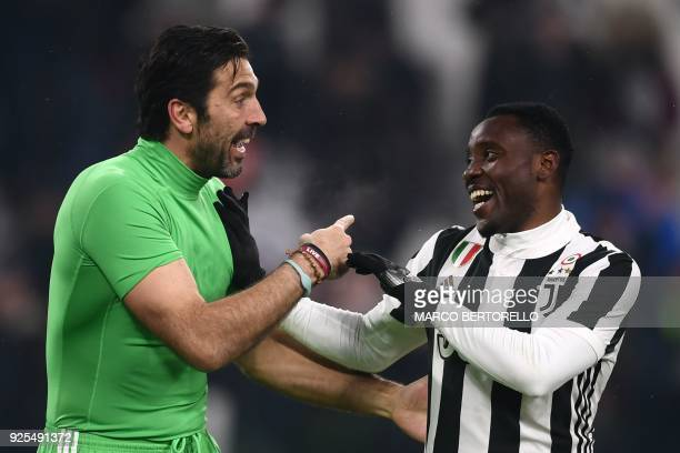 Juventus' midfielder Kwadwo Asamoah from Ghana chats with Juventus' goalkeeper Gianluigi Buffon during the Italian Tim Cup football match between...