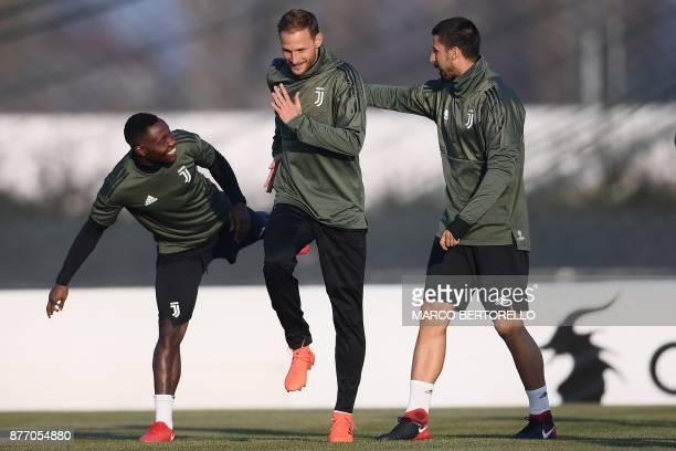 Juventus' midfielder Kwadwo Asamoah from Ghana Juventus's defender Benedikt Howedes from Germany and Juventus' midfielder Sami Khedira from Germany...