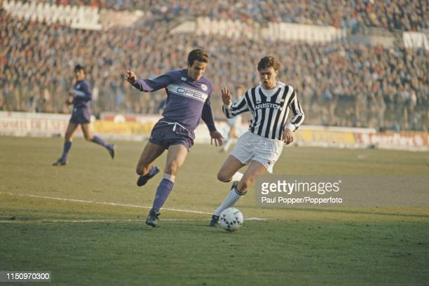 Juventus midfielder Lionello Manfredonia pictured with the ball as ACF Fiorentina defender Sergio Battistini moves in for a tackle during play...
