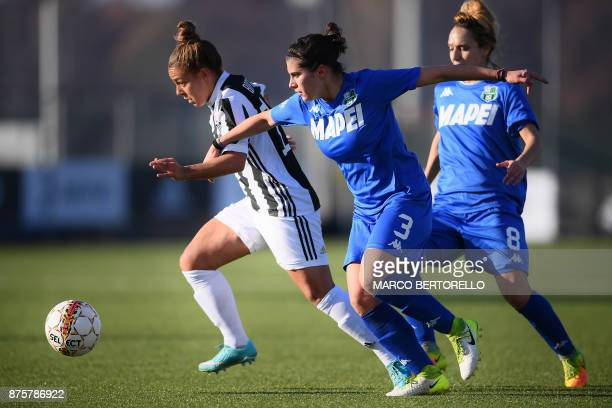 Juventus' midfielder Martina Rosucci fights for the ball with Sassuolo's defender Giulia Bursi during the Women's Italian football match between...