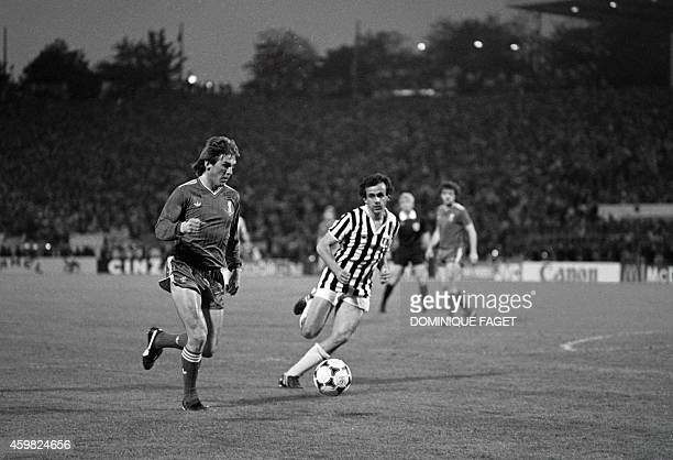 Juventus midfielder Michel Platini vies with a Liverpool's player on May 29 1985 during the European Champion Clubs final at the Heysel stadium in...