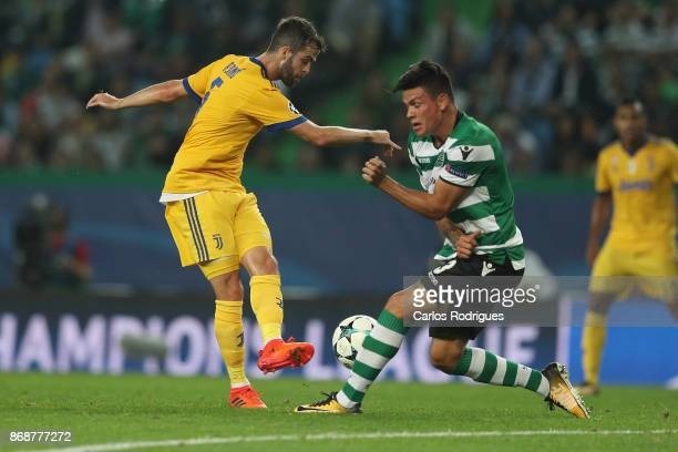 Juventus midfielder Miralem Pjanic from Bosnia and Herzegovina vies with Sporting CP defender Jonathan Silva from Argentina for the ball possession...