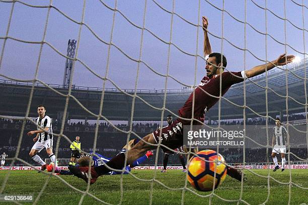 Juventus' midfielder Miralem Pjanic of BosniaErzegovina scores during the Italian Serie A football match Torino vs Juventus on December 11 2016 at...
