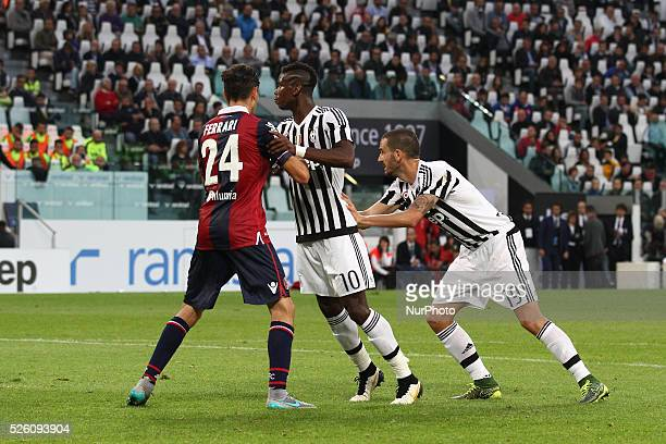Juventus midfielder Paul Pogba and Juventus defender Leonardo Bonucci vies with Bologna defender Alex Ferrari during the Serie A football match n.7...