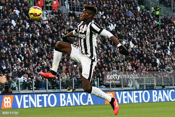 Juventus midfielder Paul Pogba reaches for the ball during the Serie A football match n20 JUVENTUS CHIEVO VERONA on 25/01/15 at the Juventus Stadium...