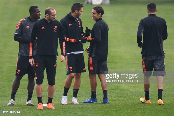 Juventus midfielder Rodrigo Bentancur from Uruguay and Juventus forward Paulo Dybala from Argentina attend the training session at the Juventus...