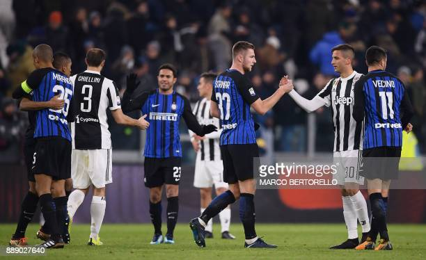 Juventus' midfielder Rodrigo Bentancur from Uruguay shakes hands with Inter Milan's defender Milan Skriniar from Slovenia at the end of the Italian...