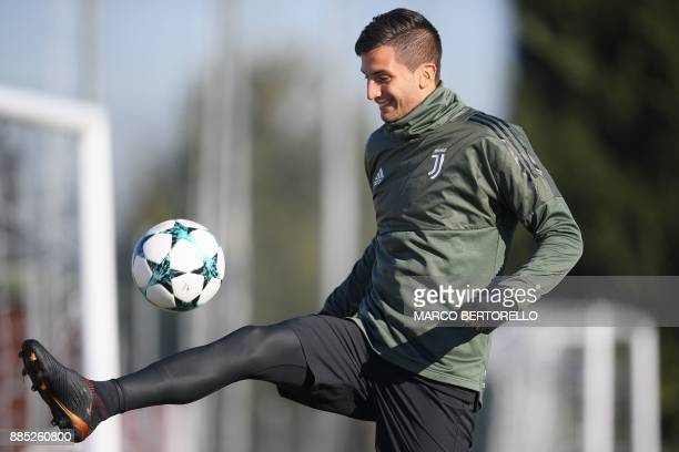 Juventus' midfielder Rodrigo Bentancur from Uruguay takes part in a training session on the eve of the UEFA Champions League football match...