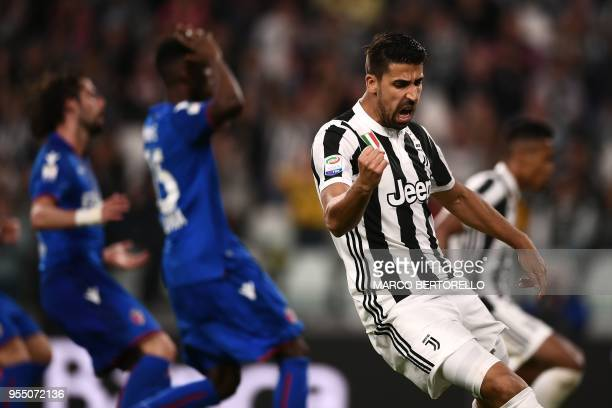 TOPSHOT Juventus' midfielder Sami Khedira from Germany celebrates after the owngoal of Bologna during the Italian Serie A football match between...