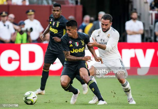 Juventus midfielder Sami Khedira moves the ball away from Real Madrid defender Daniel Carvajal during an International Champions Cup match between...