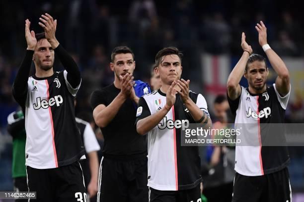 Juventus' midfielder Uruguay's Rodrigo Bentancur Juventus' forward Argentine Paulo Dybala and Juventus' defender Uruguay's Martin Caceres react at...
