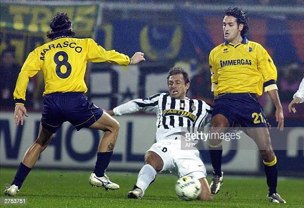 Juventus midfileder Antonio Conte is tackled by Modena midfielder Antonio Marasco and Nicola Amoruso during their Serie A match in Modena 22 November...