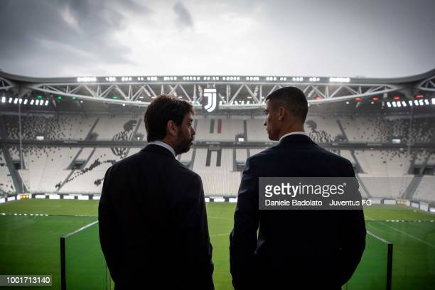 Juventus new signing Cristiano Ronaldo and Juventus president Andrea Agnelli look on before attending a press conference on July 16 2018 in Turin...